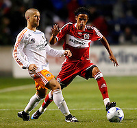 Chicago Fire forward Calen Carr (3) tries to intercept a pass by Houston Dynamo defender Wade Barrett (24).  The Houston Dynamo defeated the Chicago Fire 2-1 at Toyota Park in Bridgeview, IL on May 17, 2008.
