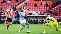 31st October 2020; Bramall Lane, Sheffield, Yorkshire, England; English Premier League Football, Sheffield United versus Manchester City; Raheem Sterling of Manchester City comes in for the ball as Sheffield United Goalkeeper Aaron Ramsdale heads the ball clear of the goal area