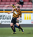Alloa keeper Scott Bain holds off Livy's Callum Fordyce.