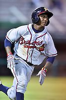 Danville Braves shortstop Ozhaino Albies #17 runs to first during a game against the Johnson City Cardinals at Howard Johnson Field September 4, 2014 in Johnson City, Tennessee. The Braves defeated the Cardinals 6-1. (Tony Farlow/Four Seam Images)