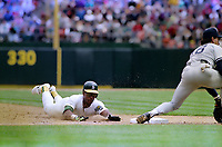 OAKLAND, CA:  Rickey Henderson of the Oakland Athletics steals base number 939, making him the all-time stolen base leader during the game against the New York Yankees on May 1, 1991 at the Oakland Coliseum in Oakland, California. (Photo by Brad Mangin)