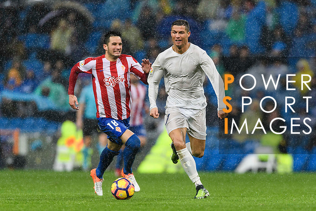 """Cristiano Ronaldo of Real Madrid battles for the ball with Manuel Castellano """"Lillo"""" of Real Sporting de Gijon during the La Liga match between Real Madrid and Real Sporting de Gijon at the Santiago Bernabeu Stadium on 26 November 2016 in Madrid, Spain. Photo by Diego Gonzalez Souto / Power Sport Images"""