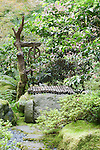 Secluded Bamboo Bench on rock with pathway, Portland, Oregon, Japanese Garden.  The Japanese Garden in Portland is a 5.5 acre respit.  Said to be one of the most authentic Japanese Garden's outside of Japan, the rolling terrain and water features symbolize both peace and strength.