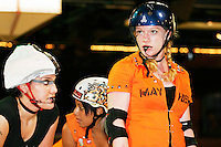 The Queens of Pain battle the Manhattan Mayhem at a Gotham Girls Roller Derby bout on June 17, 2005.