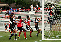 BOYDS, MARYLAND - July 21, 2012:  Hayley Siegel (12) of DC United Women (out of the picture) beats Marbel Egwuenu (0) of the Virginia Beach Piranhas from a direct free kick to score the second goal during a W League Eastern Conference Championship semi final match at Maryland Soccerplex, in Boyds, Maryland on July 21. DC United Women won 3-0.