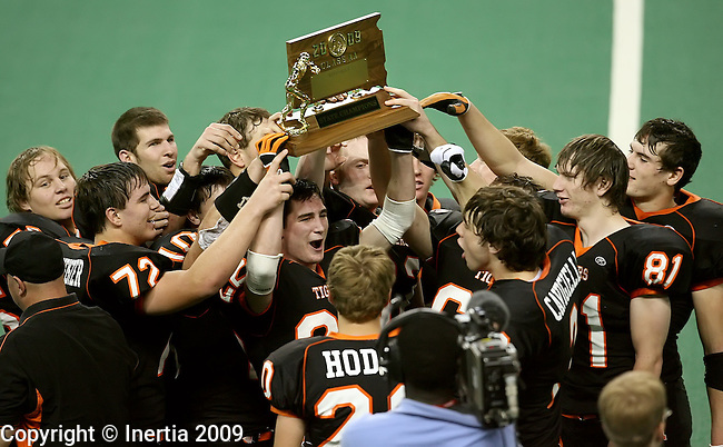 VERMILLION, SD - NOVEMBER 13: Dan Noonan #22 of Howard hoists the championship trophy after the Tigers defeated the Emery-Ethan Seahawks 40-16 in the South Dakota Class 9AA Championship game Friday, Nov. 13, 2009 at the DakotaDome in Vermillion, South Dakota. (Photo by Dave Eggen/Inertia)