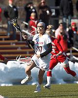 Boston College midfielder Mikaela Rix (17) brings the ball forward. .Boston College (white) defeated Boston University (red), 12-9, on the Newton Campus Lacrosse Field at Boston College, on March 20, 2013.