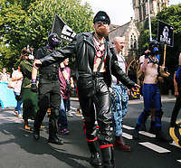 A man in leather outfit joins thousands of people in this year's Pride Parade in the centre of Cardiff, Wales, UK. Sayurday 26 August 2017