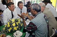 Nelson Mandela has lunch at the home of a wealthy white land owners during his campaign for President.  After more then 27 years in jail as an anti-apartheid activist,   Nelson Mandela lead a 1994 campaign for President as a member of the African National Congress (ANC),  in the first free elections in South Africa in 1994.  Mandela has received more than 250 awards over four decades, including the 1993 Nobel Peace Prize.