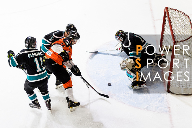 Cathay Flyers Goalie Jasen Await (R) makes a save on Devin Welsh of HK Tigers (C) during the Mega Ice Hockey 5s match between Cathay Flyers and HK Tigers on May 04, 2018 in Hong Kong, Hong Kong. Photo by Marcio Rodrigo Machado / Power Sport Images