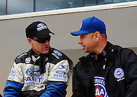 Sept. 18, 2011; Concord, NC, USA: NHRA funny car driver Robert Hight (right) talks with Bob Tasca III during the O'Reilly Auto Parts Nationals at zMax Dragway. Mandatory Credit: Mark J. Rebilas-