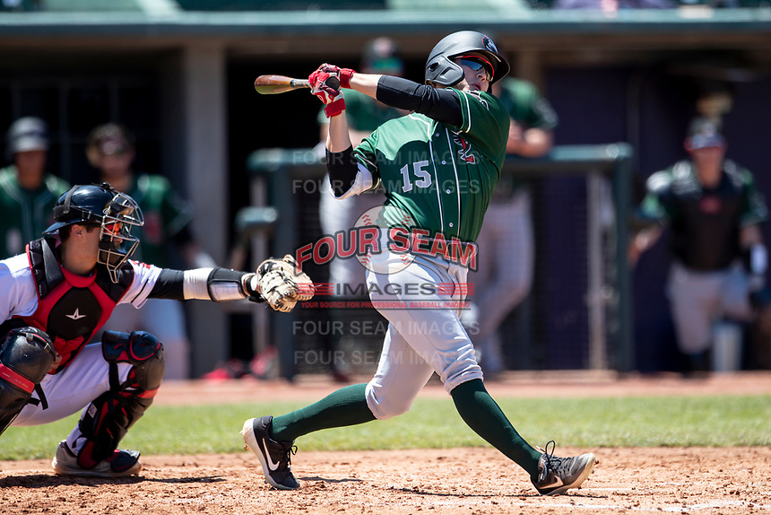 Great Lakes Loons outfielder Ryan Ward (15) follows through on his swing on May 30, 2021 against the Lansing Lugnuts at Jackson Field in Lansing, Michigan. (Andrew Woolley/Four Seam Images)