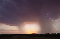Lightning and storm clouds at sunset, near Lubbock, Texas.  Posie and I spent many summer afternoons and evenings chasing storms around the South Plains, looking for wild weather and sometimes finding it.