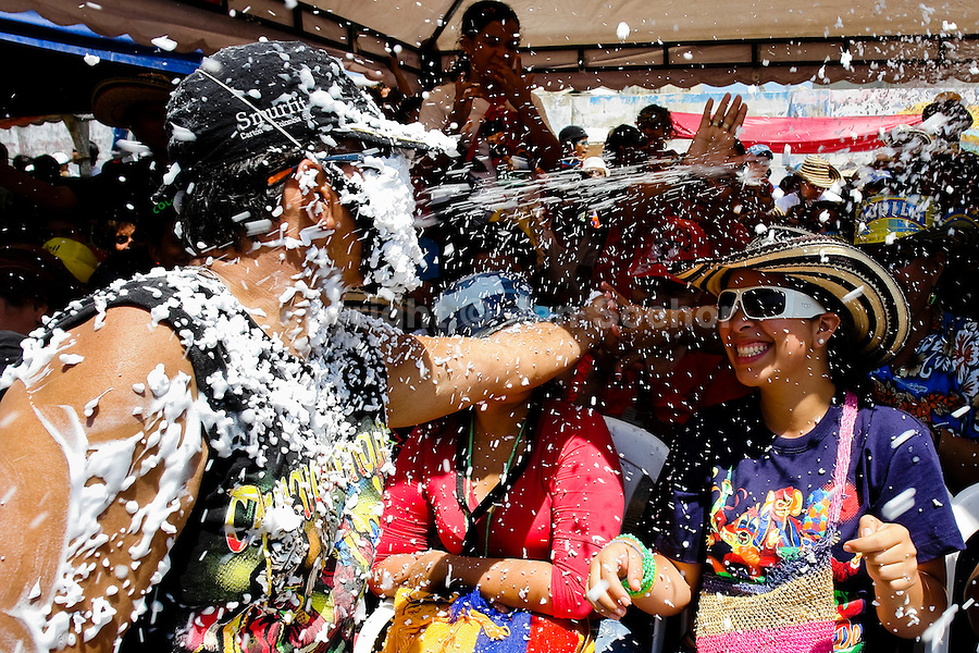 A Colombian man hit by foam stream during the Carnival in Barranquilla, Colombia, 25 February 2006. The Carnival of Barranquilla is a unique festivity which takes place every year during February or March on the Caribbean coast of Colombia. A colourful mixture of the ancient African tribal dances and the Spanish music influence hit for five days nearly all central streets of Barranquilla. Those traditions kept for centuries by Black African slaves have had the great impact on Colombian culture and Colombian society. In November 2003 the Carnival of Barranquilla was proclaimed as the Masterpiece of the Oral and Intangible Heritage of Humanity by UNESCO.