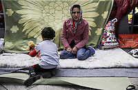 Pictured: A migrant woman and her son in Victoria Square, Athens Monday 29 February 2016<br /> Re: Hundreds of migrants have been living in Victoria Square in central Athens Greece
