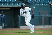 Luis Robert (21) of the Winston-Salem Dash takes his lead off of third base against the Wilmington Blue Rocks at BB&T Ballpark on April 15, 2019 in Winston-Salem, North Carolina. The Dash defeated the Blue Rocks 9-8. (Brian Westerholt/Four Seam Images)