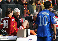 Roma 19/2/2006 Campionato Italiano Serie A <br /> Roma Empoli 1-0<br /> AS Roma's Francesco Totti is carried on a stretcher off the pitch with a fractured fibula and strained ligaments in his left ankle following a rough tackle during the Italian Serie A soccer match against Empoli at the Olympic stadium in Rome February 19, 2006. <br /> Francesco Totti infortunato lascia il campo.<br /> foto Andrea Staccioli Insidefoto