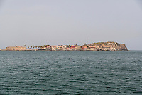 Approaching Goree Island from the Dakar-Goree Ferry, Senegal.  Fort d'Estrees (1850) on left, Le Castel on right, highest point on the island, and site of World War II gun emplacements.
