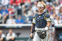 Michigan Wolverines catcher Joe Donovan (0) during Game 11 of the NCAA College World Series against the Texas Tech Red Raiders on June 21, 2019 at TD Ameritrade Park in Omaha, Nebraska. Michigan defeated Texas Tech 15-3 and is headed to the CWS Finals. (Andrew Woolley/Four Seam Images)