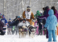 Saturday, March 3, 2012  Five-time Iditarod winner, Rick Swenson, shakes hands with fans at the Ceremonial Start of Iditarod 2012 in Anchorage, Alaska.