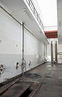 Concrete white tiled fermentation tanks inside the winery. Vinarija Citluk winery in Citluk near Mostar, part of Hercegovina Vino, Mostar. Federation Bosne i Hercegovine. Bosnia Herzegovina, Europe.