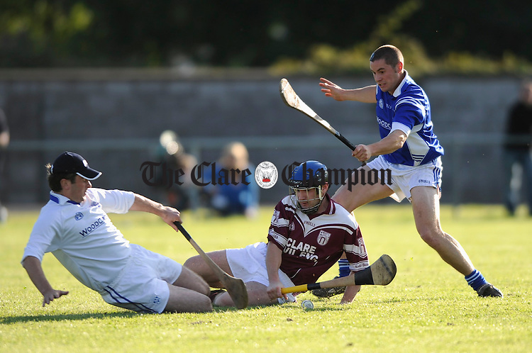 Cratloe Goalie Sean Hawes makes a save from St Joseph's Paul Dullaghan as Cratloe's David Ryan looks on during their game at Clareabbey. Photograph by John Kelly.