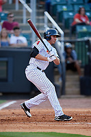 Jackson Generals designated hitter Rudy Flores (11) follows through on a swing during a game against the Chattanooga Lookouts on April 29, 2017 at The Ballpark at Jackson in Jackson, Tennessee.  Jackson defeated Chattanooga 7-4.  (Mike Janes/Four Seam Images)