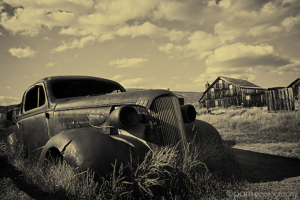 Abandoned car and house in Bodie California