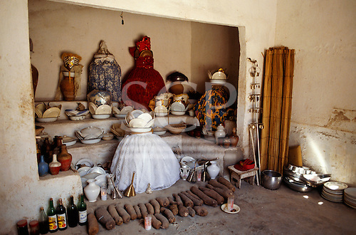Recife, Pernambuco State, Brazil. Candomble festival: altar of food, candles and dishes.