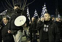 MP Ilias Kassidiaris (R) joins members of far right group Golden Dawn (Chrysi Avgi) as they march