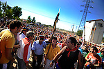 People surround the young man (C) that stabbed the bull to death during 'Toro de la Vega' festival, on September 13, 2011 in Tordesillas. The festival is one of the oldest in Spain with roots dating back to the fifteenth century. The bull has to be enticed across the river from the village to the plain 'Vega' before it can be killed to honour the 'Virgen de la Pena'.   © Pedro ARMESTRE.