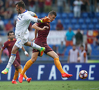Calcio, Serie A: Roma vs Sampdoria. Roma, stadio Olimpico, 11 settembre 2016.<br /> Roma's Edin Dzeko, right, kicks to score during the Italian Serie A football match between Roma and Sampdoria at Rome's Olympic stadium, 11 September 2016. Roma won 3-2.<br /> UPDATE IMAGES PRESS/Isabella Bonotto