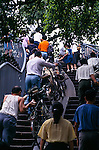 bicycle ramp, crowd of people pushing bikes up ramps during rush hour in Guangzhou (Canton), China, Asia