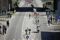 A red flag (procedure) is held in front of the peloton to neutralise the break as further down the parcours in Arenzano a landslide has completely obstructed the course and the race organisers are recalculating the route as it unfolds...<br /> <br /> 107th Milano-Sanremo 2016