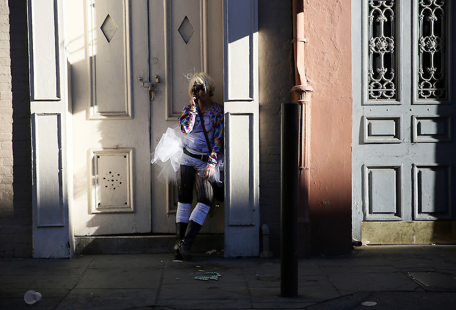 NEW ORLEANS, LOUISIANA - FEBRUARY 9, 2016:  A reveler talks on her phone during Mardi Gras day on February 9, 2016 in New Orleans, Louisiana. Fat Tuesday, or Mardi Gras in French, is a celebration traditionally held before the observance of Ash Wednesday and the beginning of the Christian Lenten season. (Photo by Jonathan Bachman/Getty Images)