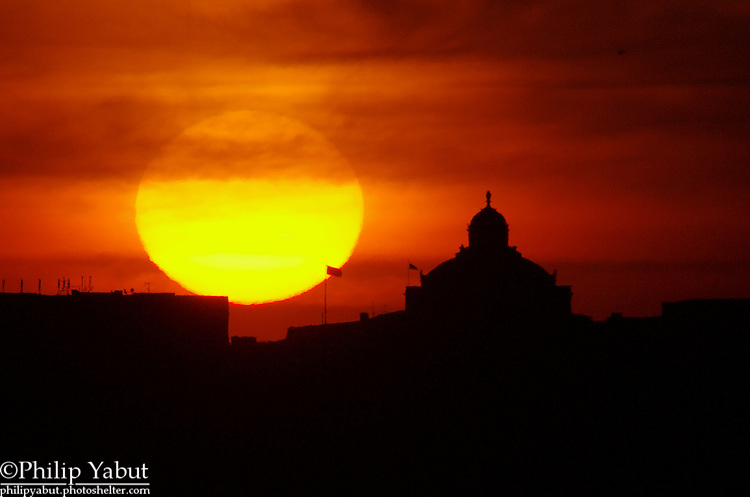 The sun rises near the Library of Congress' Jefferson Building dome.