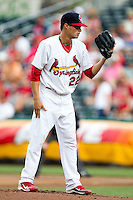 Joe Kelly (22) of the Springfield Cardinals reads the pitch sign during a game against the Northwest Arkansas Naturals at Hammons Field on July 31, 2011 in Springfield, Missouri. Northwest Arkansas defeated Springfield 9-1. (David Welker / Four Seam Images)
