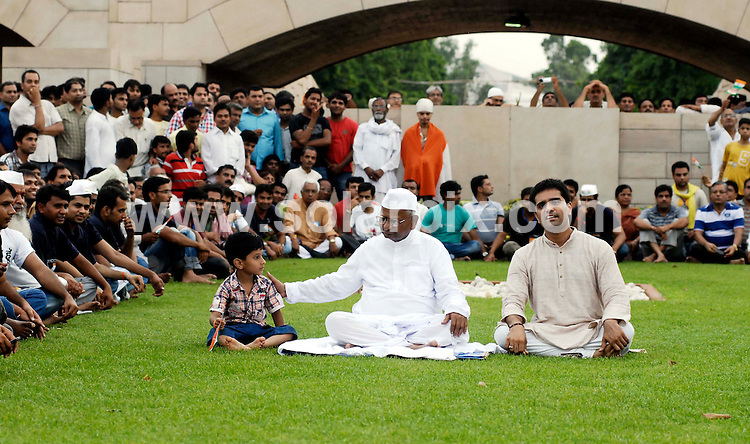 """**ALL ROUND PICTURES FROM SOLARPIX.COM**                                             **WORLDWIDE SYNDICATION RIGHTS**                                                                                  A veteran Indian anti-corruption campaigner headed for a showdown with police on Monday when he vowed to court arrest after being banned from beginning a hunger strike in the capital, Delhi..Activist Anna Hazare had planned to begin a """"fast unto death"""" on Tuesday to pressure the government to add more teeth to a new anti-corruption law that is under consideration in parliament..Indian Social activist Anna Hazare during his visit to Rajghat on Monday 15th August 2011 on the eve of his hunger strike for a stronger Lokpal Bill.                                                                 This pic:     Anna Hazare                                                                                         JOB REF:   13843     SJA       DATE:  15.08.11                                                          **MUST CREDIT SOLARPIX.COM OR DOUBLE FEE WILL BE CHARGED**                                                                      **MUST AGREE FEE BEFORE ONLINE USAGE**                               **CALL US ON: +34 952 811 768 or LOW RATE FROM UK 0844 617 7637**"""