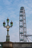 UK, England, London.  London Eye Ferris Wheel, Millenium Wheel, and Westminster Bridge Lamppost.