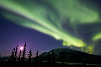Moon and aurora borealis over the Brooks Range, Arctic, Alaska.