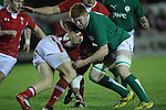 Ireland number 8 tackles Wales centre Steffan Hughes..Under 20 Six Nations.Wales v Ireland.Eirias - Colwyn Bay.01.02.13.©Steve Pope