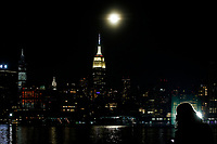 NEW JERSEY, HOBOKEN - FEBRUARY 27: Moon rises behind the Empire State Building on February 27, 2021 as it's seen from Hoboken. New Jersey. New York City has seen an increase in leases signed since the 2008 financial crisis, only in Manhattan the increase was 58%, with 6,255 leases signed during the year. (Photo by Emaz/VIEWpress via Getty Images)
