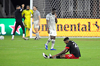 WASHINGTON, DC - NOVEMBER 8: Donovan Pines #23 of D.C. United sits on the field after a game between Montreal Impact and D.C. United at Audi Field on November 8, 2020 in Washington, DC.