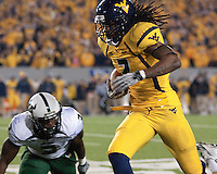 WVU defensive back Robert Sands returns an interception. The West Virginia Mountaineers defeated the South Florida Bulls 20-6 on October 14, 2010 at Mountaineer Field, Morgantown, West Virginia.