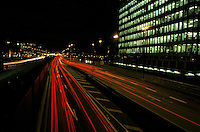 Traffic on a city highway at night near La Défense business district, Paris, France.