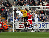ATTENTION SPORTS PICTURE DESK<br /> Pictured: Dorus de Vries goalkeeper for Swansea (2nd L) deflects the ball from a Charlton corner, pushed by Darren Ward of Charlton (3rdL), assisted by team mate Guillem Bauza (L) and Garry Monk (R)<br /> Re: Coca Cola Championship, Swansea City FC v Charlton Athletic at the Liberty Stadium, Swansea, south Wales. 28 February 2009<br /> Picture by D Legakis Photography / Athena Picture Agency, Swansea 07815441513
