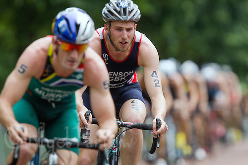 31 MAY 2014 - LONDON, GBR - Gordon Benson (GBR) (centre) of Great Britain drafts Richard Murray (RSA) (left) of South Africa  on the bike during the men's 2014 ITU World Triathlon Series round in Hyde Park, London, Great Britain (PHOTO COPYRIGHT © 2014 NIGEL FARROW, ALL RIGHTS RESERVED)