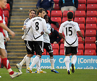 Pictured L-R: Angel Rangel of Swansea celebrating his equaliser with team mates Andrea Orlandi and Wayne Routledge. Saturday 07 January 2012<br /> Re: FA Cup football Barnsley FC v Swansea City FC at the Oakwell Stadium, south Yorkshire.