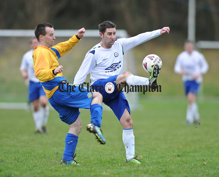 Martin Mc Namara of Mountshannon in action against Niall Mc Nevin of Ennis Town during their game at Lees Road. Photograph by John Kelly.