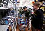 Carson City Sheriff's Deputy Daniel Reece shops with Seth, 13, at the 15th annual Holiday with a Hero program at Walmart in Carson City, on Wednesday, Dec. 19, 2018. The program, which pairs local heroes with more than 200 K-8th graders, provides a $100 Christmas shopping spree at Walmart.  <br /> Photo by Cathleen Allison/Nevada Momentum